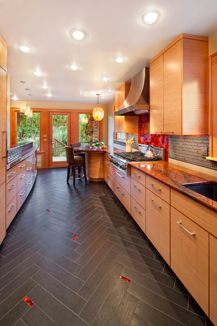 Dark Kitchen Tiles with Red Glass Accents